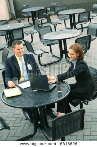 Two Business People Sit Outdoor