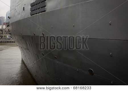 NEW YORK - MAY 22: The gray port side of the hull of the amphibious dock landing ship USS Oak Hill (LSD 51) moored at Pier 92 during Fleet Week NY on May 22, 2014.