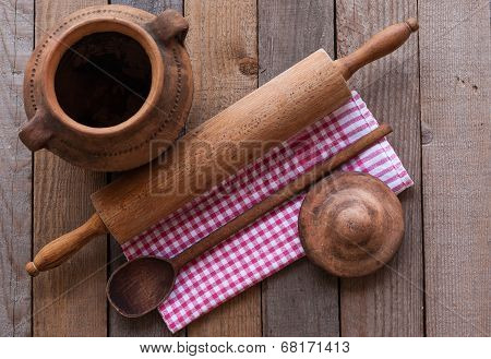 Old Crock With Rolling Pin