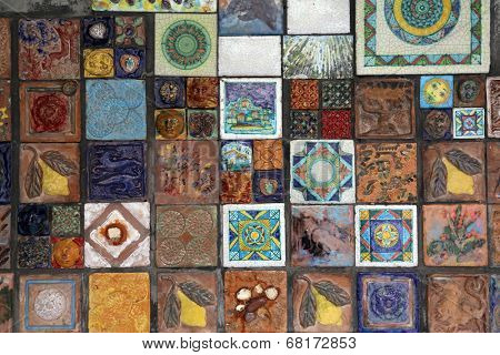 RIOMAGGIORE, ITALY - MAY 02: Decorative tiles on wall. Riomaggiore, one of the Cinque Terre villages, UNESCO World Heritage Sites, on May 02, 2014, in Riomaggiore, Cinque Terre, Italy
