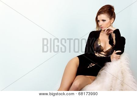beautiful, elegant girl with big breast black bodysuit in the Studio on a white background