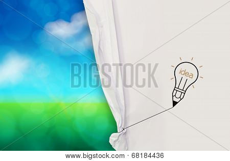 Light Bulb Idea Drawing Rope To Open Crumpled Paper To Show Green Nature Background As Concept
