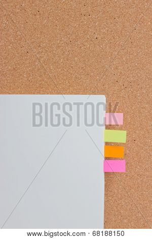 Sticking Reminder On Notepad With Corkboard.