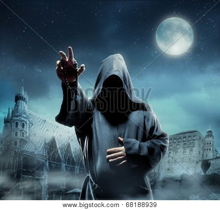 Medieval monk at night