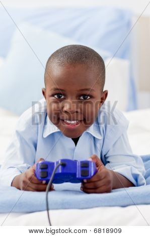 Cute Little Boy Playing Video Game
