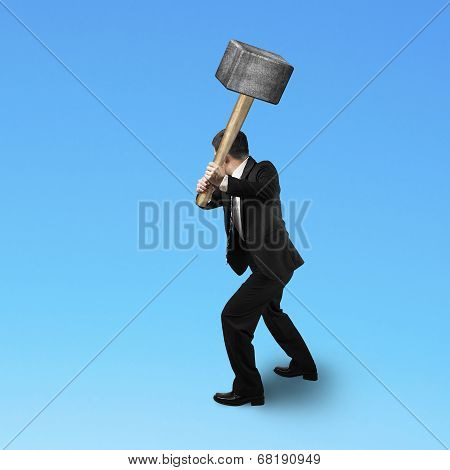 Businessman Holding A Sedge Hammer