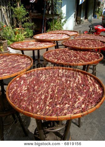 Bacon drying in the sun, Thailand.
