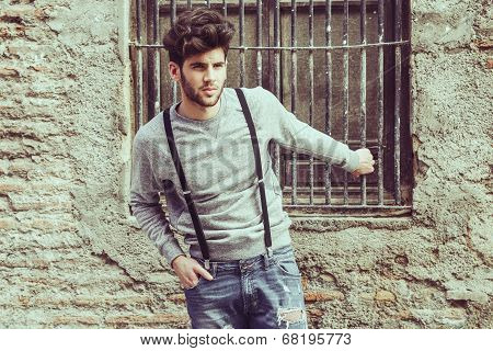Man Wearing Suspenders In Urban Background