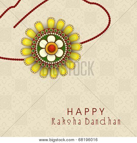 Beautiful rakhi on seamless floral decorated brown background for the festival of Raksha Bandhan.