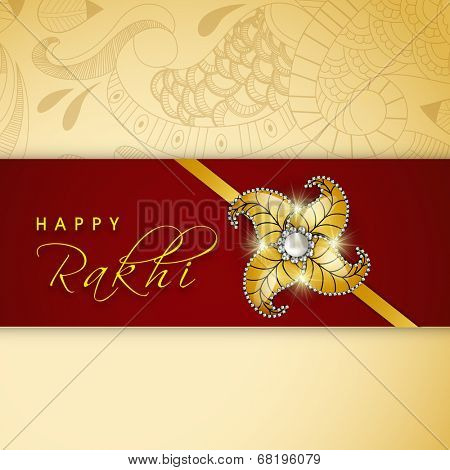 Shiny golden rakhi on floral decorated maroon and beige background for Happy Raksha Bandhan celebrations.