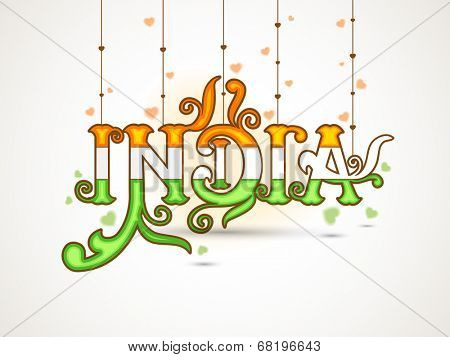 Stylish text India in National Flag colors on grey background for 15th of August, Independence Day celebrations.