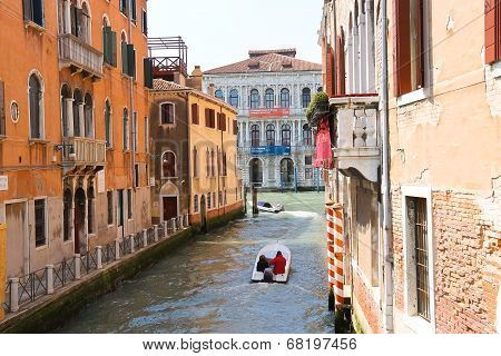 People Move Through The Channel On The Boat In Venice, Italy
