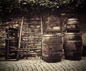 image of traditional  - Ancient traditional wine press and oak barrels on Italian street outside restaurant - JPG
