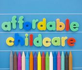 pic of babysitting  - Magnetic letters spelling Affordable Childcare on a blue board - JPG