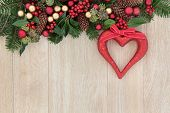 stock photo of greenery  - Christmas background border with red heart decoration - JPG