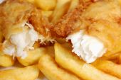 foto of hake  - Closeup of a piece of flaky cod broken into two pieces