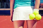 pic of youg  - Youg pretty girl playing tennis on cort - JPG