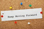 image of mantra  - The phrase Keep Moving Forward typed on a piece of paper and pinned to a cork notice board - JPG