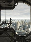 image of armor suit  - Science fiction illustration of a lone Space Marine guard watching over the skyline of a future city - JPG