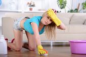 foto of dust mites  - Beautiful housewife cleans the floor at home - JPG
