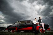 pic of car symbol  - Young couple next retro car - JPG