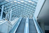 foto of escalator  - blue diminishing escalator - JPG