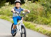 foto of safety  - Riding a bicycle for the first time on a country road concept for healthy lifestyle - JPG