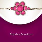 stock photo of rakhi  - Beautiful rakhi on grey and purple background for Happy Raksha Bandhan celebrations - JPG