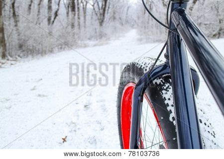 Winter biking on a Fat tire bike. Shallow focus. Focus on Bicycle Fork.