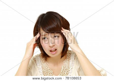 woman suffers from headache