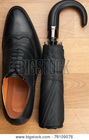 Classic Mens Shoes And  Umbrella  On The Wooden Floor