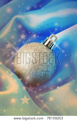 Beautiful Christmas ball on satin cloth, close-up