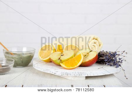 Homemade facial masks with natural ingredients, on color wooden table, on light background