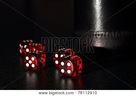 Red Dice With A Black Dice Cup