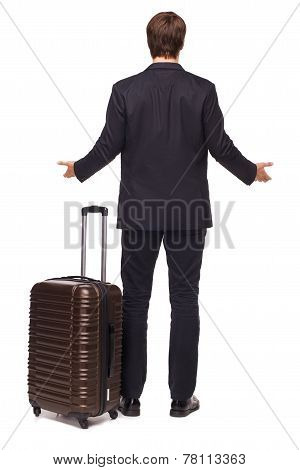 Surprised businessman with suitcase
