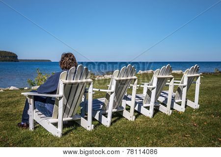 Lady Sitting In Beach Chair With Copy Space