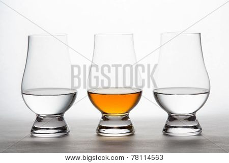 Whiskey And Vodka In Crystal Tasting Glasses