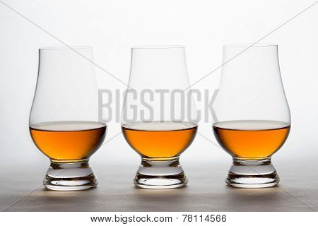 Whiskey In Three Crystal Tasting Glasses
