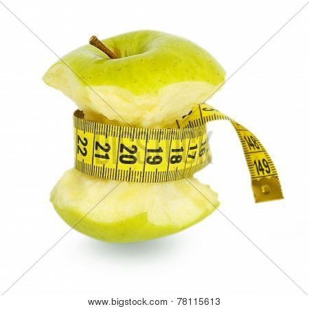Green Apple Core And Yellow Measuring Tape