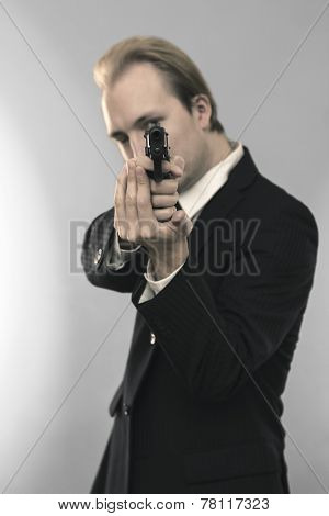 Business Man Holding A Gun