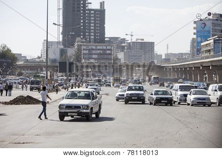 ADDIS ABABA, ETHIOPIA-OCTOBER 31, 2014: Unidentified people go about business in downtown Addis Ababa, Ethiopia with the Pan African Chamber of Commerce in the background.