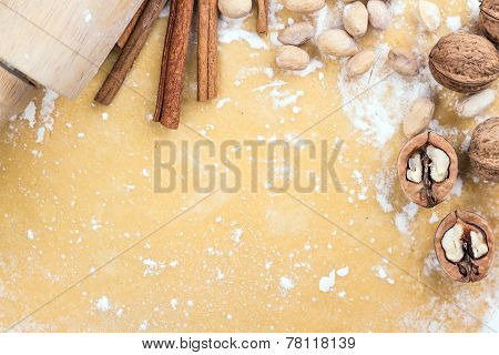 Background of the dough with plunger and spices