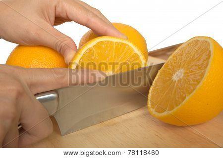 Woman hand cut orange