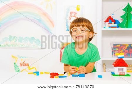 Happy clever little boy play with blocks