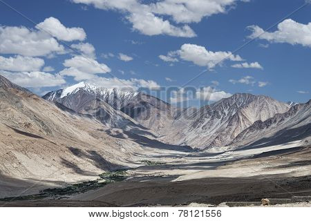 Remote Village In Valley Among High Desert Mountains