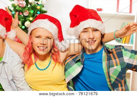 Teen boys and girl on New year party