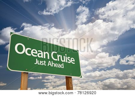 Ocean Cruise Just Ahead Green Road Sign with Dramatic Clouds and Sky.