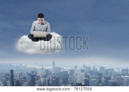 Man Using Laptop Over Cloud 1