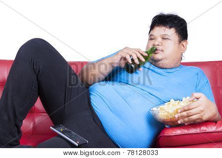 Overweight Man Sitting Lazy On Sofa 1
