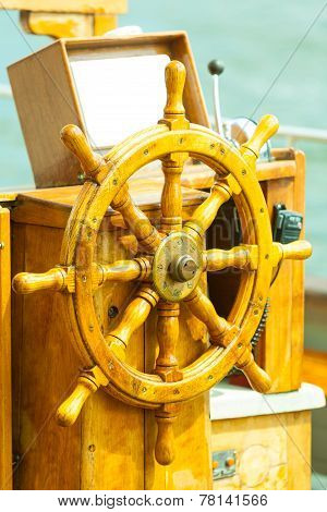Yachting. Ship Wooden Steering Wheel. Sailboat Detail.